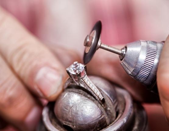 Jeweler polishing the diamond ring.